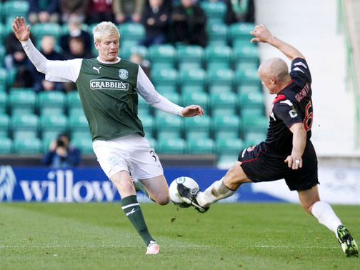 Ryan McGivern and Jim Goodwin battle for the ball