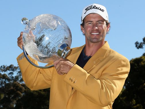 Adam Scott poses with his trophy.