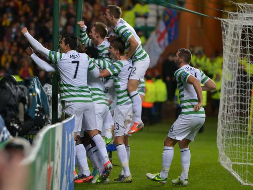 Celtic enjoy the 2-1 victory over Barcelona.
