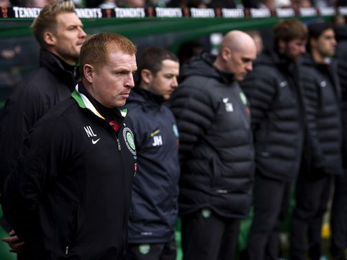 Neil Lennon stands silent before the game