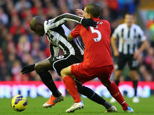 Demba Ba takes on Daniel Agger