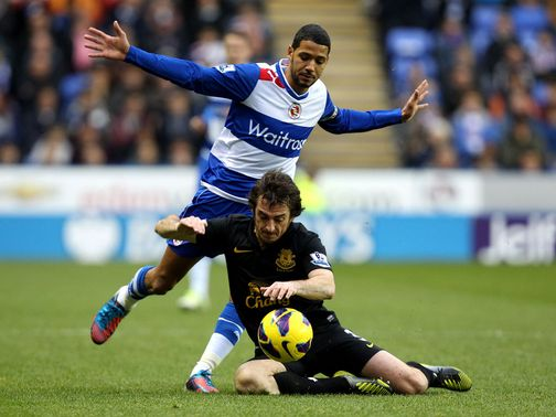 Jobi McAnuff and Leighton Baines battle for the ball