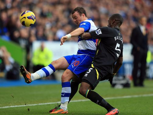 Noel Hunt and Sebastien Bassong battle for the ball