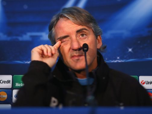 Roberto Mancini faces the press on Tuesday.