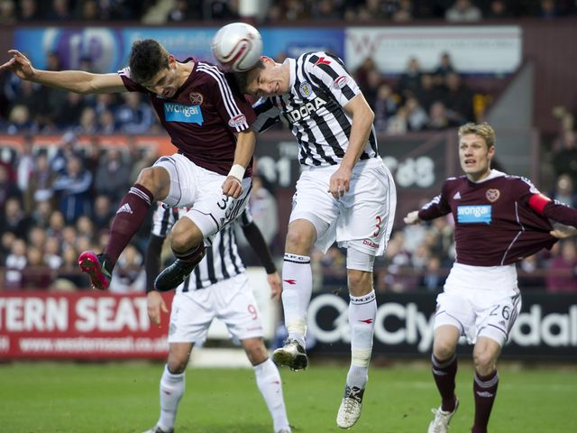 Paul Dummett wins the aerial battle with Callum Paterson
