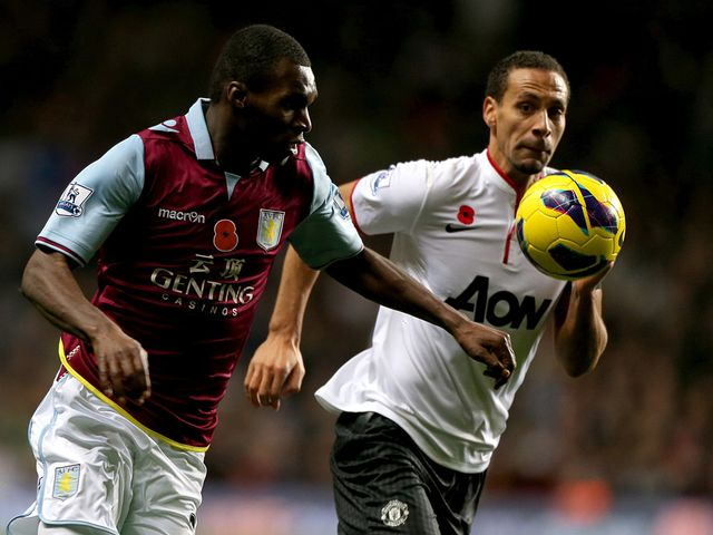 Christian Benteke and Rio Ferdinand battle for the ball