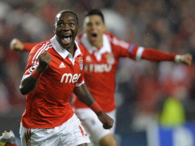 Ola John celebrates his early goal for Benfica