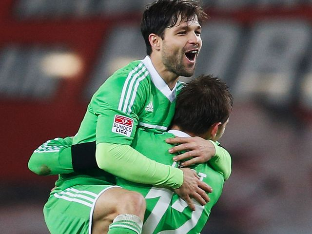 Diego and Bas Dost celebrate Wolfsburg equaliser