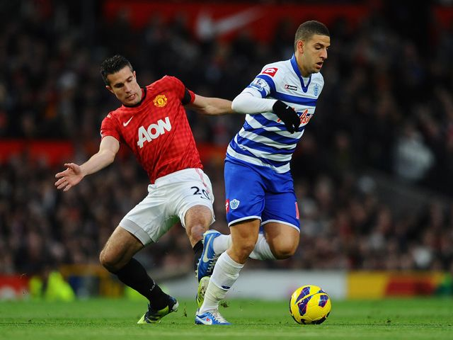 Robin van Persie and Adel Taarabt battle for the ball