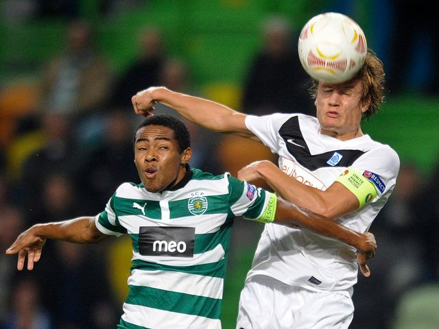 Elias Trindade and Jelle Vossen battle for the ball