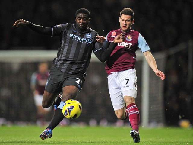 Kolo Toure and Matt Jarvis battle for the ball
