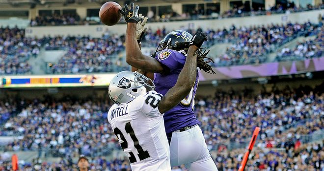 Torrey Smith catches a touchdown pass for Baltimore