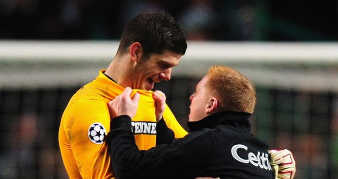Delighted: Lennon (right) and Celtic 'keeper Fraser Forster celebrate the win over Barcelona
