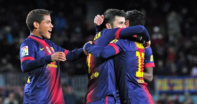 David Villa: Celebrates with Barca team-mates