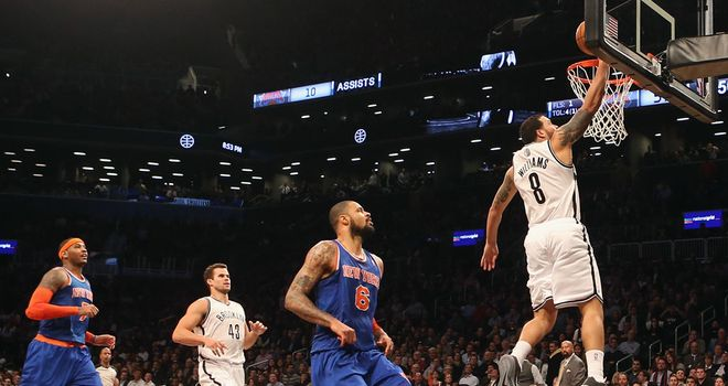 Deron Williams lands a two-pointer during the third period of Brooklyn Nets' derby clash with New York Knicks