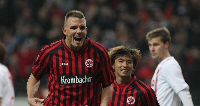 Two-goal Alexander Meier celebrates