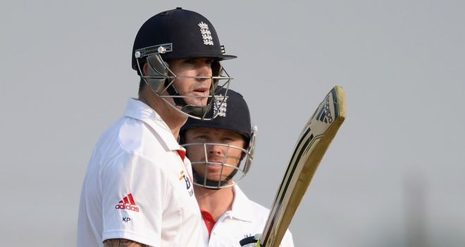 Ian Bell watches as Kevin Pietersen makes hay against Haryana