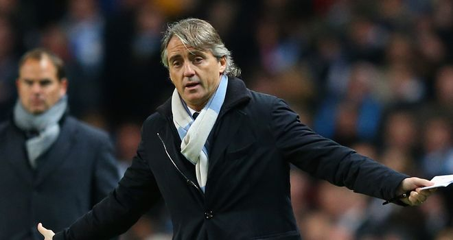 Roberto Mancini: Realistic about Manchester City's chances of progressing in the Champions League