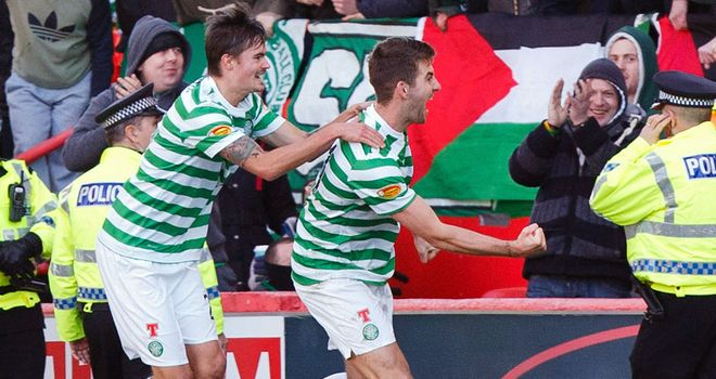 Charlie Mulgrew: Celebrates second for Celtic