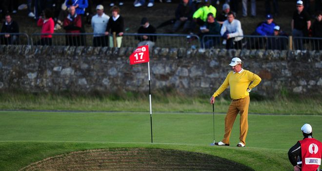 Miguel Angel Jimenez inspects the famous bunker at the 17th