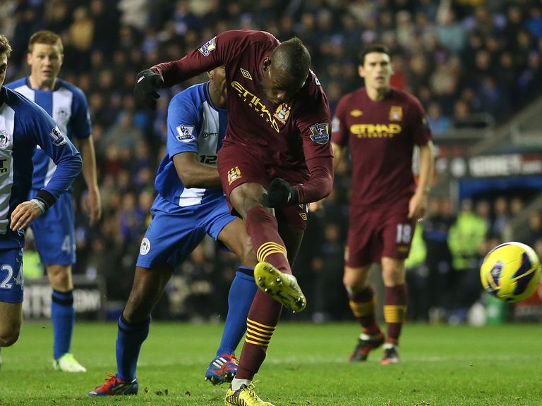 Mario Balotelli scores against Wigan to the delight of Cheeky