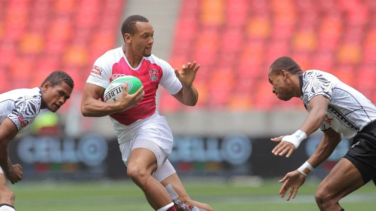 England star Dan Norton tries to avoid the Fiji defence at the Nelson Mandela Bay Sevens (Photo: IRB/Carl Fourie)