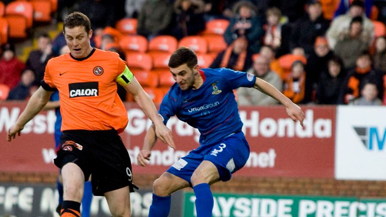 Daly and Graeme Shinnie: Battling for the ball