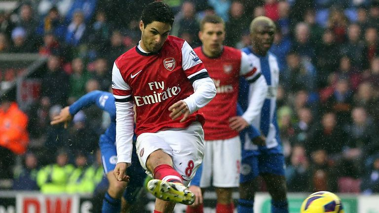 Mikel Arteta secures the spoils at a soggy DW Stadium from the spot