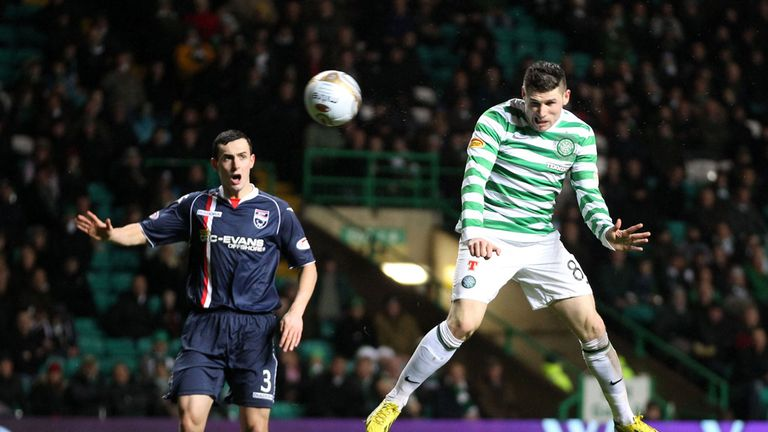 Hooper heads his second of the game at Celtic Park