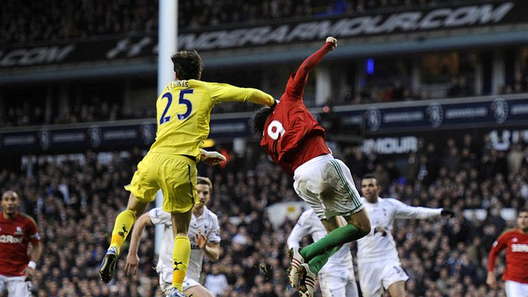 Michu collides with Tottenham keeper Hugo Lloris