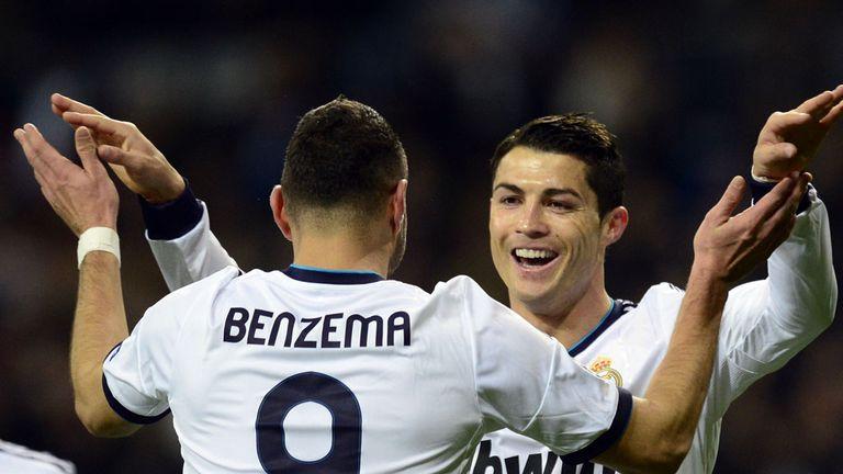 Cristiano Ronaldo celebrates with Karim Benzema following his goal