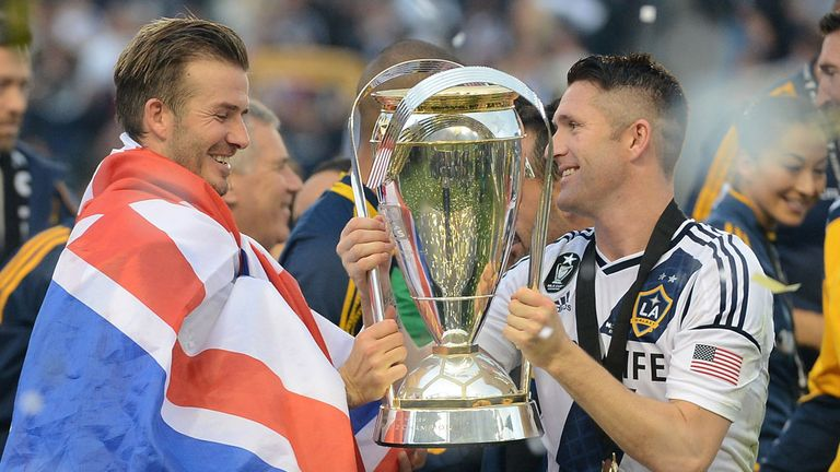David Beckham and Robbie Keane lift the MLS Cup
