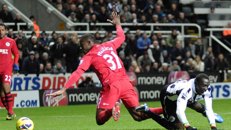 Papiss Cisse takes a tumble under the challenge of Maynor Figueroa