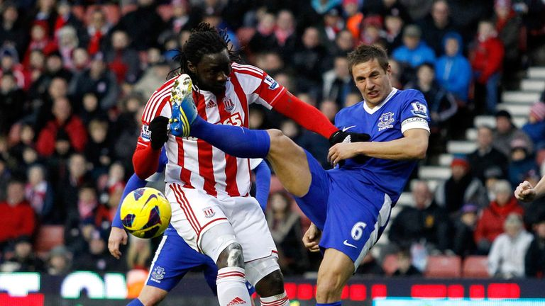 Everton's Phil Jagielka tussles with Stoke striker Kenwyne Jones during the 1-1 draw between the sides in December