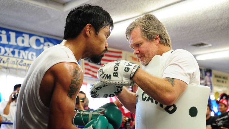 Freddie Roach has urged Manny Pacquiao not to return too soon