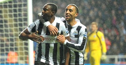 Shola Ameobi celebrates late winner with James Perch