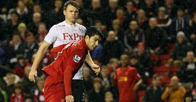 Luis Suarez netted an injury time fourth