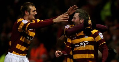 Bradford celebrate after taking a shock lead against Arsenal