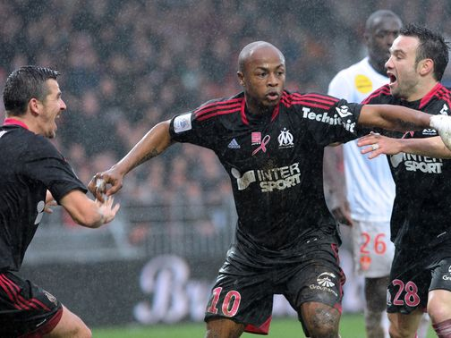 Andre Ayew enjoys his goal for Marseille.