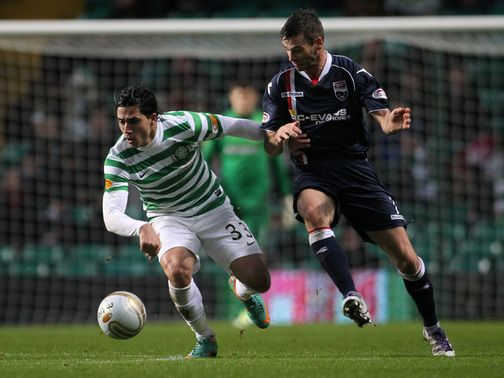 Beram Kayal and Colin McMenamin battle for the ball