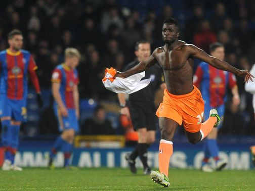 Nouha Dicko celebrates his late leveller for Blackpool