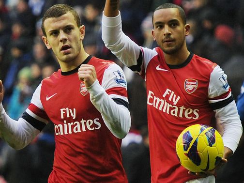 Wilshere (l) wants Walcott to join him in signing a new contract