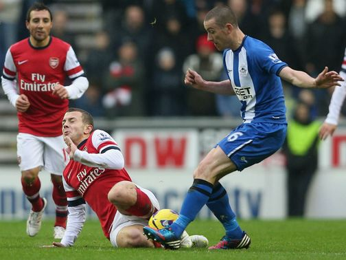 Jack Wilshere gets stuck in at the DW