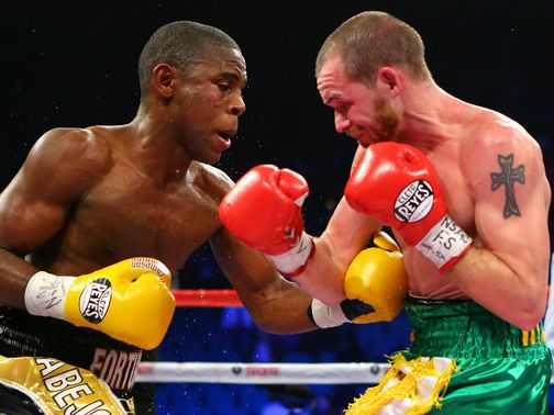 Tough battle: Javier Fortuna throws a left to the body of Patrick Hyland
