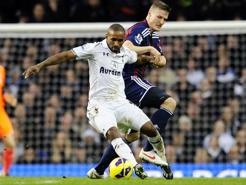 Defoe and Huth compete for possession