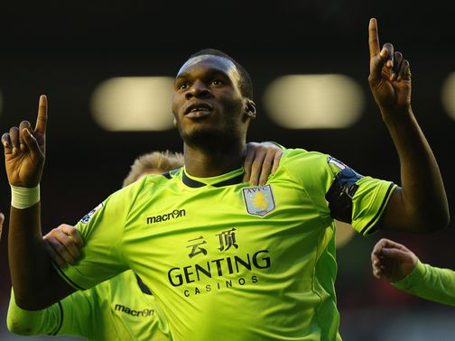 Christian Benteke celebrates at Anfield