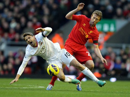 Gaston Ramirez and Lucas Leiva battle for the ball