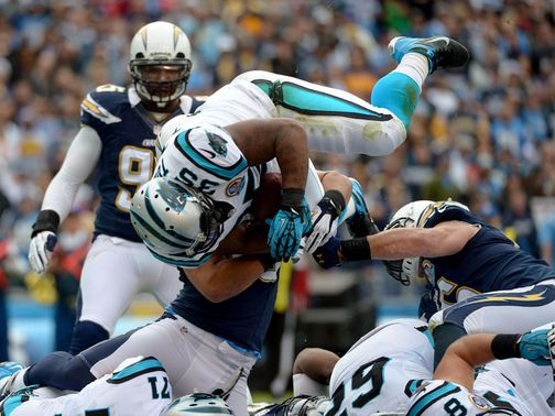 Tolbert dives in to score against his old team