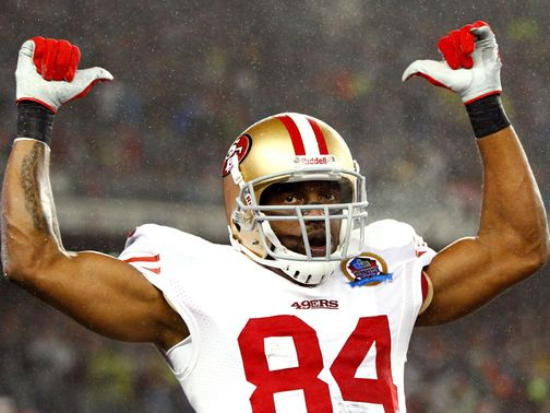 Randy Moss celebrates a 49ers touchdown