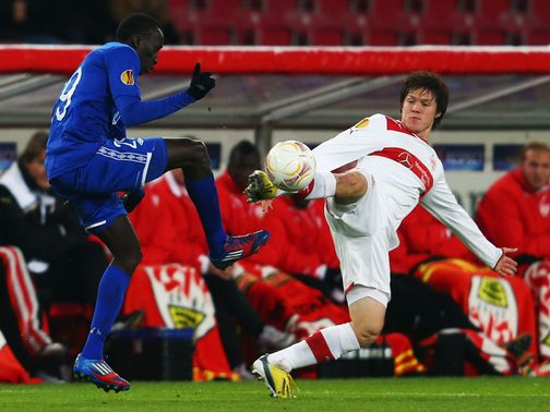 Pape Pate Diouf and Gotoku Sakai battle for possession
